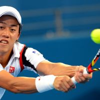 Tough luck: Kei Nishikori plays a shot before retiring injured from his Brisbane International semifinal against Andy Murray on Saturday. | AFP-JIJI