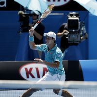 End of the line: Kei Nishikori plays a shot during his fourth-round match against David Ferrer at the Australian Open on Sunday. Ferrer won 6-2, 6-1, 6-4. | AP