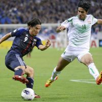 On the run: Japan's Shinji Okazaki (left) and Iraq's Khaldoun Ibrahim work for positioning in their 2014 World Cup qualifier in Saitama. Japan defeated Iraq 1-0. | KYODO
