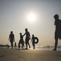 Beach bums:  Tourists walk on the beach in Chaung Tha, Myanmar, earlier this month. | BLOOMBERG