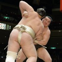 Walking wounded: Hakuho (rear) grapples with Baruto at the New Year Grand Sumo Tournament on Monday. | KYODO