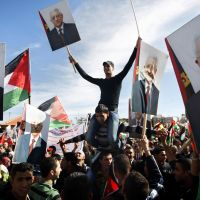 Hero's welcome: Palestinians gathered in the West Bank city of Ramallah on Sunday hold pictures of President Mahmoud Abbas as they celebrate their recent successful bid to win U.N. statehood recognition. | #### NO #### NO CAPTIONS FOUND FOR THIS FILE (p6 Abbas 20121204) #### S FOUND FOR THIS FILE (P6 ABBAS 20121204) ####