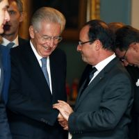 Running debate: Italian Prime Minister Mario Monti (left) talks with French President Francois Hollande in Oslo after the Nobel Peace Prize ceremony on Monday. | AFP-JIJI