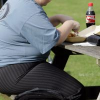Tucking in: An overweight person eats in London. Around the world, people are grappling with the diseases of modern life. | AP