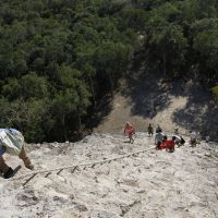 Severe outlook:  Tourists earlier this month climb a pyramid at an archaeological site in Coba, Mexico, ahead of the end of the Mayan Long Count calendar. | AP