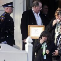 Teacher mourned: Family and friends leave the wake of Victoria Soto, a teacher at Sandy Hook Elementary School, in Stratford, Connecticut, on Tuesday. | AP