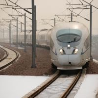 Fast travel: A high-speed train arrives at a platform in Hebei Province, south of Beijing, on Saturday. China showed off the final link of the world's longest high-speed rail route, set to completely open Wednesday, which will stretch from the capital, Beijing, to the southern city of Guangzhou. | AP