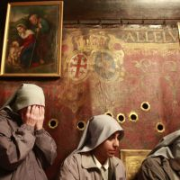 Where faiths intersect: Sisters from the Franciscan order pray  Tuesday inside the grotto at the Church of the Nativity in the West Bank city of Bethlehem, which is believed to be the birthplace of Jesus Christ. | AFP-JIJI