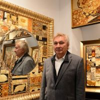 Amber king: Artist Lucjan Myrta poses among his amber masterpieces at his home in Sopot, Poland. | AFP-JIJI