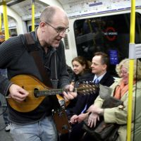 Major milestone: A busker entertains travelers on the London Underground in January 2007. | AP