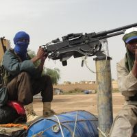 Holy warriors: Fighters from the Islamic group Movement for Oneness and Jihad in West Africa, one of several islamist groups fighting in Mali, guard Gao Airport in August. | AFP-JIJI