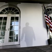 Presidential aura: The shadow of President Barack Obama is cast on a wall as he leaves a news conference at the White House in Washington in October 2009. | AP