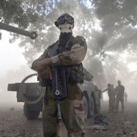 Angel of death?: A French soldier wearing a skeleton mask stands next to an armored car in Niono, Mali, on Sunday. | AFP-JIJI