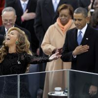 Out of sync?: Beyonce sings — or possibly lip-syncs — 'The Star-Spangled Banner' during the ceremonial swearing-in of President Barack Obama at the U.S. Capitol in Washington on Monday. | AP