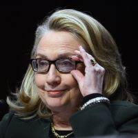 Seeing to business: Hillary Rodham Clinton gives some of her last formal testimony as U.S. secretary of state at one of two congressional hearings held Wednesday. | AFP-JIJI