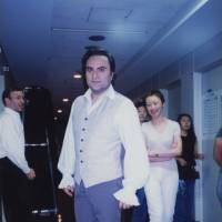 Communication: Missa Takahashi (second from right) interprets for Italian tenor Giuseppe Sabbatini (center) backstage during the performances of French composer Jules Massenet's opera 'Manon' at the New National Theatre, Tokyo, in July 2001. | MISSA TAKAHASHI