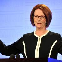 Looking ahead: Australian Prime Minister Julia Gillard speaks at the National Press Club in Canberra on Wednesday. On Saturday, three days after announcing that a general election will be held in September, two senior ministers bolted from her Cabinet. | BLOOMBERG