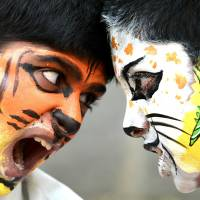 Easy prey: Indian students take part in the Save Tiger Campaign organized in Bangalore on Jan. 31. A new report by Human Rights Watch says young victims of sexual assault in India are frequently humiliated by the police and mistreated by doctors. | AFP-JIJI