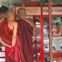 Going digital: In Myanmar's telecoms boom, some may even be seeking out sutra apps.