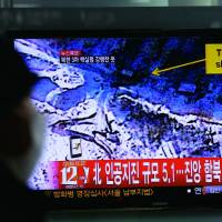Atomic power: A South Korean man watches a news report in Seoul about a nuclear test conducted by North Korea on Tuesday. | AP