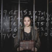 Lockup: Elly Chau, a staff member of 'real escape game' Freeing HK, shows off one of the rooms where players in Hong Kong are pitted against a ticking clock as they desperately try to work their way out by finding clues, cracking codes and solving puzzles. | AFP-JIJI