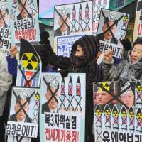 Testing times: Activists from an anti-North Korea group protest in Seoul on Tuesday against Pyongyang's latest nuclear test. | AFP-JIJI