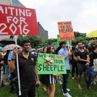 Enough: Demonstrators gather in Singapore on Saturday to listen to views on immigration issues. Protesters called for an immigration slowdown after a government report showed the city-state's population rose by 30 percent to almost 7 million in less than 20 years. | AFP-JIJI