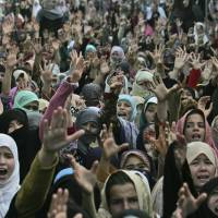 Call to action: Shiite Muslim women shout slogans Sunday in Quetta, Pakistan, during a protest to condemn a bombing a day earlier that killed 81 members of the minority community. | AP