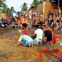 Prayer meet: Foreign tourists take part in a ceremony for British teenager Scarlett Keeling on Anjuna beach in Goa, India, days after she was raped and left for dead in February 2008. | AFP-JIJI