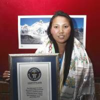 Woman honored for climbing Everest twice in eight days