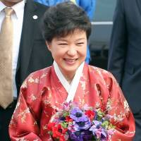 Change of tack?: South Korean President Park Geun Hye is seen in a variety of outfits she wore on the day of her official inauguration ceremony Monday, when she become the country's first female leader. | KYODO