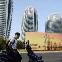 To let: Luxury apartment blocks line the seaside city of Sanya, Hainan Province, once billed as China's 'Dubai.' | AFP-JIJI