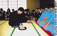 Musashino Higashi's autistic students perform a tea ceremony for their peers and students of the International School of the Sacred Heart (above); the students of both schools proudly show off the signboards they made together.