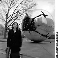 Former JET Nicole Deutsch stands in front of a sculptured globe outside the U.N. Secretariat in New York.