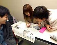 Waseda University students read The Japan Times during a class given by Norio Hozaki.