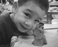 Kids at the American school in Japan's Early Learning Center are creating clay figures for the large-scale 'Children's Field' project.