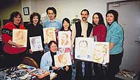 Andy Boerger (third from right) helped his class to perfect pastels; teacher Ryu Kadosaka examines a student's drypoint print. (below)