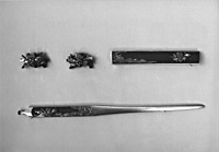 This set of midokoromono - or three 'distinctive features' of the sword - were made by Goto Hojo and depict scenes from the story 'The Race at Uji River.' Clockwise from top left are menuki (sword peg caps), kozuka (pocket knife) and kogai (multipurposed instrument). | PHOTOS COURTESY OF SEIKADO BUNKO ART MUSEUM