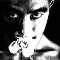 Eikoh Hosoe's 'Kamaitachi #8' (1965) of Yukio Mishima (above); 'Man and Woman #15' (1961) | COURTESY OF THE ARTIST