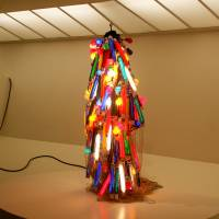 Bright lights in New York City: Atsuko Tanaka's 'Electric Dress' (above) of painted incandescent light bulbs, electric cords and a control console (1956, refabricated in 1986), from the collection of the Takamatsu City Museum of Art. | EDWARD M. GOMEZ