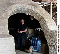 Robert Yellin standing in the entrance of Bizen potter Togaku Mori's 90 meter kiln in Ushimado, Okayama Prefecture (2004)