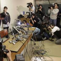 Bad timing: Ryuji Sonoda, head coach of Japanese women's judo national team, bows before a press conference in Tokyo. Sonoda resigned over accusations he physically abused female judoka at a training camp before the London Olympics. | AP