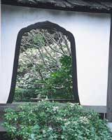 The bell-shaped window in the Keishunin sub-temple's gardens