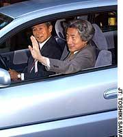 Prime Minister Junichiro Koizumi takes a spin in a hydrogen-powered Honda FCX.