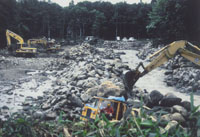 Diggers at work on river construction after the flood (above), and the tranquil scene last month.