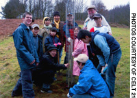Wales-resident Japanese and other local members of the Thriving Woodpeckers Club at Afan Forest Park in South Wales -- which is twinned with out Afan Woodland Trust in Kurohime, Nagano Prefecture -- plant another sapling in the Japanese woodland garden now being created there.