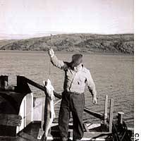 The engineer of the M.V. Radium Gillbert with one of the lake's renowned huge pike thet he lended.