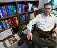 Bob Lanza, vice president of medical and scientific development at Advanced Cell Technology, sits in his office at the company's headquarters in Worcester, Massachusetts, in November 2004. Poorly handled publicity over his team's recent major breakthrough in stem-cell research has fueled controversy it might oyherwise have calmed.