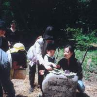 Eiji's daughter Yume, his older sister and grandson at the memorial stone in our Afan woods.