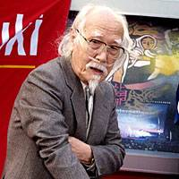 Director Seijun Suzuki makes a handprint to be placed on PIFF Square